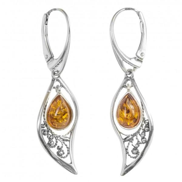 Boucle d'oreille Nature en Argent accompagné d'une perle d'ambre flottant