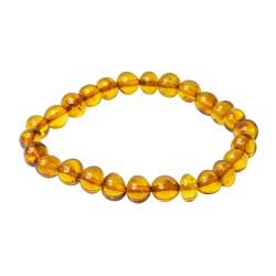 Bracelet adulte perle ronde baroque d'ambre miel