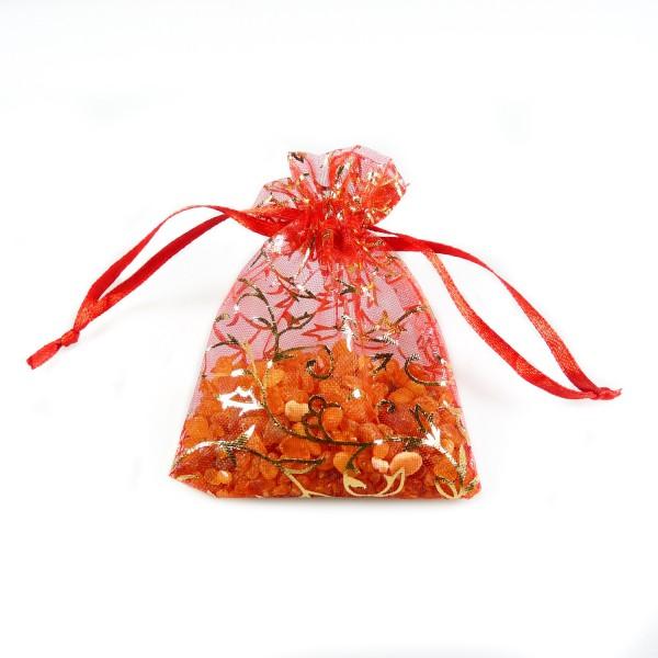 Sachet d'ambre brut dans son sachet d'organza rouge