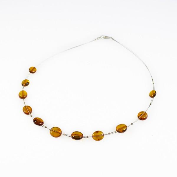 Collier d'ambre adulte couleur miel sur cable acier
