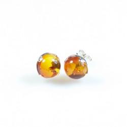 Silber-Ohrring und natürlicher bernsteinfarbener Honig / Schnaps